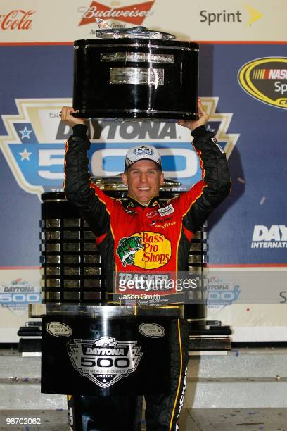 Jamie McMurray driver of the Bass Pro Shops/Tracker Boats Chevrolet celebrates in Victory Lane after winning the NASCAR Sprint Cup Series Daytona 500...