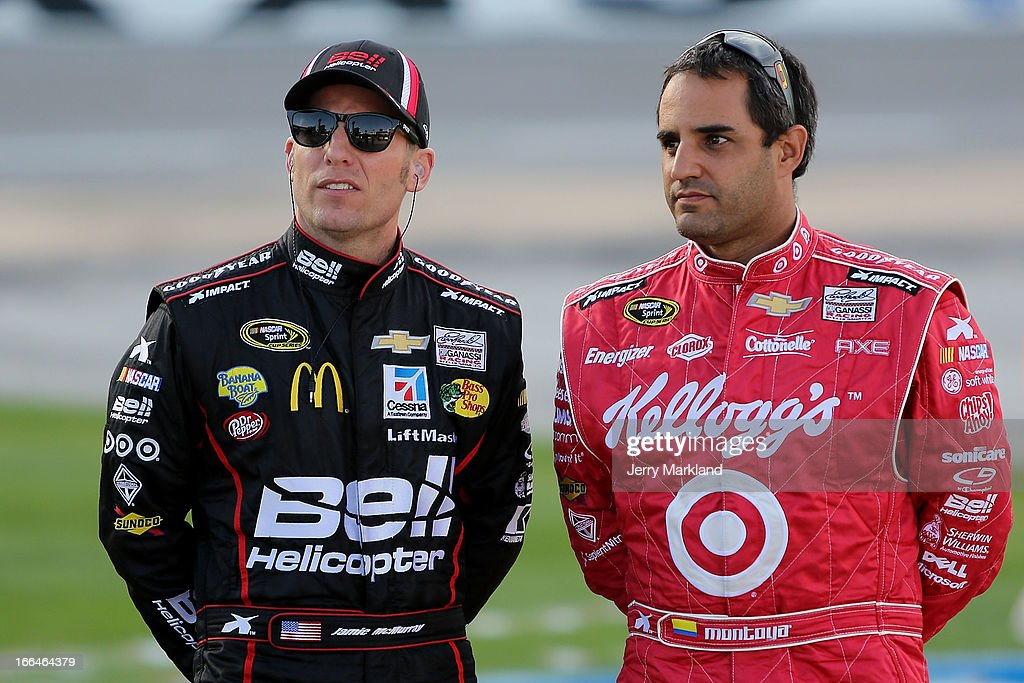 Jamie McMurray(L), driver of the #1 Bell Helicopters Chevrolet, and Juan Pablo Montoya, driver of the #42 Target/Kellogg's Chevrolet, looks on during qualifying for the NASCAR Sprint Cup Series NRA 500 at Texas Motor Speedway on April 12, 2013 in Fort Worth, Texas.