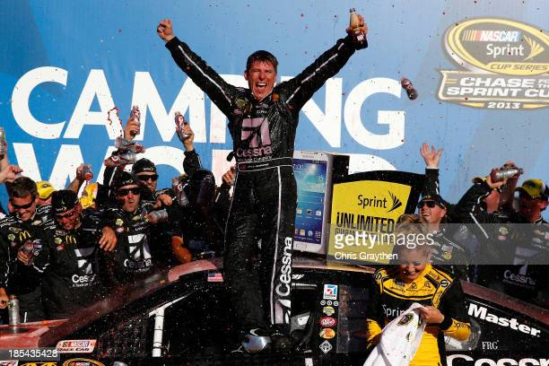 Jamie McMurray driver of the Cessna Chevrolet celebrates in Victory Lane after winning the NASCAR Sprint Cup Series Camping World RV Sales 500 at...
