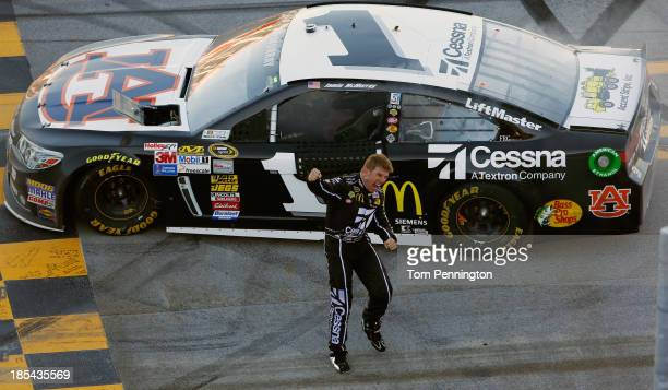 Jamie McMurray driver of the Cessna Chevrolet celebrates on track after winning the NASCAR Sprint Cup Series Camping World RV Sales 500 at Talladega...