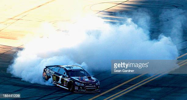 Jamie McMurray driver of the Cessna Chevrolet celebrates with a burnout after winning the NASCAR Sprint Cup Series Camping World RV Sales 500 at...