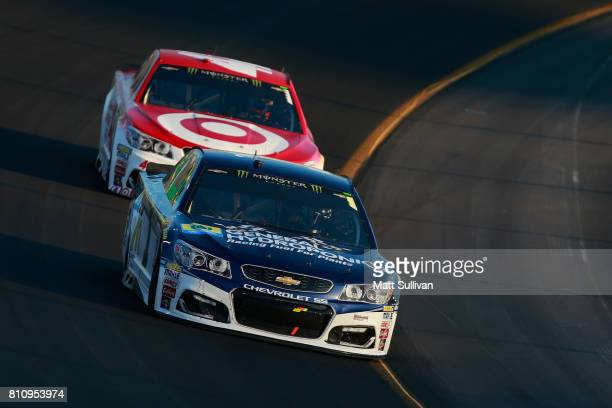 Jamie McMurray driver of the Cessna Chevrolet leads Kyle Larson driver of the Target Chevrolet during the Monster Energy NASCAR Cup Series Quaker...