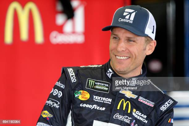 Jamie McMurray driver of the Cessna Chevrolet looks on during practice for the Monster Energy NASCAR Cup Series Axalta presents the Pocono 400 at...