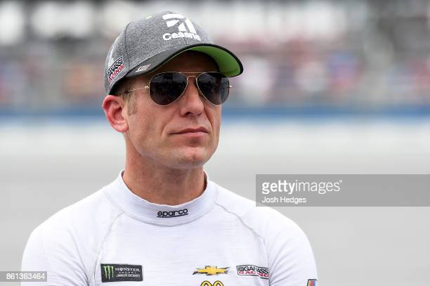Jamie McMurray driver of the Cessna Chevrolet looks on during qualifying for the Monster Energy NASCAR Cup Series Alabama 500 at Talladega...