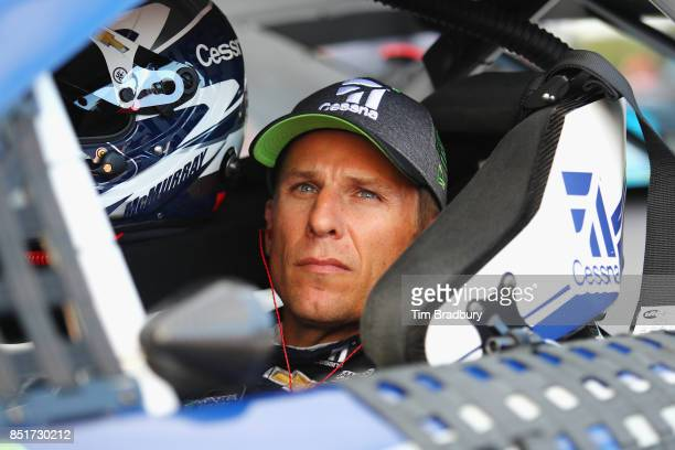Jamie McMurray driver of the Cessna Chevrolet prepares to drive during qualifying for the Monster Energy NASCAR Cup Series ISM Connect 300 at New...