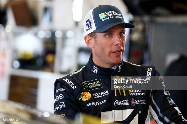 Jamie McMurray driver of the Cessna Chevrolet stands in the garage during practice for the Monster Energy NASCAR Cup Series Quaker State 400...