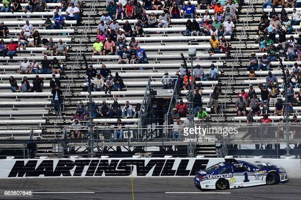 Jamie McMurray driver of the Cessna Chevrolet wrecks during the Monster Energy NASCAR Cup Series STP 500 at Martinsville Speedway on April 2 2017 in...