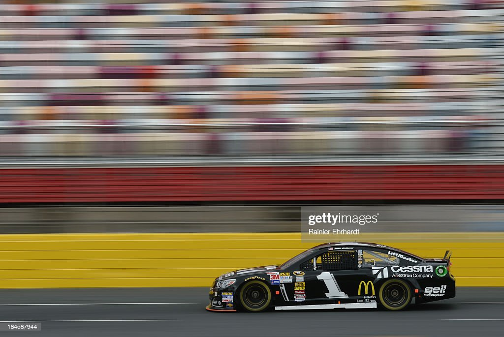 Jamie McMurray, driver of the #1 Earnhardt-Ganassi Racing Chevrolet, goes through the tri-oval during NASCAR Sprint Cup Series testing at Charlotte Motor Speedway on October 14, 2013 in Concord, North Carolina.