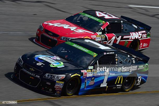 Jamie McMurray driver of the Energizer Chevrolet and Kurt Busch driver of the Haas Automation Chevrolet race during the NASCAR Sprint Cup Series...