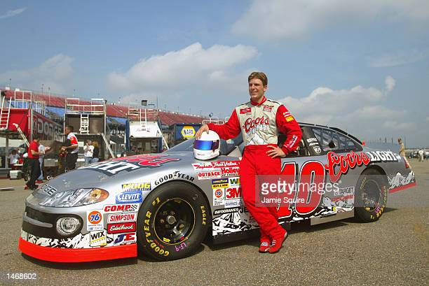 Jamie McMurray driver of the Ganassi Racing Dodge Intrepid R/T in the garage area during practice for the EA Sports 500 at Talladega Superspeedway on...