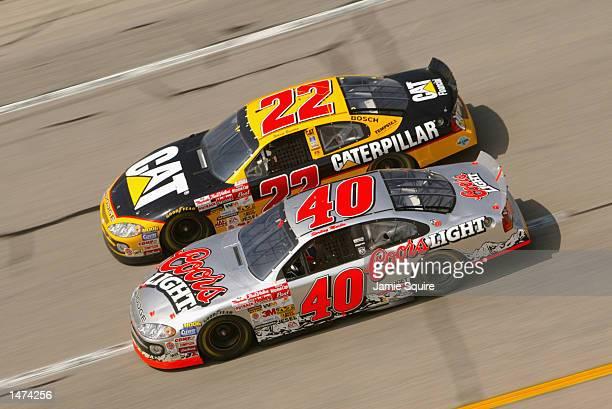 Jamie McMurray driver of the Ganassi Racing Dodge Intrepid R/T races alongside Ward Burton driver of the Bill Davis Racing Dodge Intrepid R/T during...