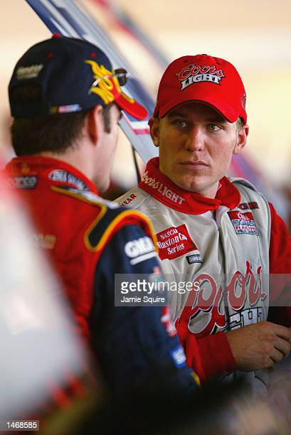 Jamie McMurray driver of the Ganassi Racing Dodge Intrepid R/T talks with Jeff Gordon during practice for the EA Sports 500 at Talladega...