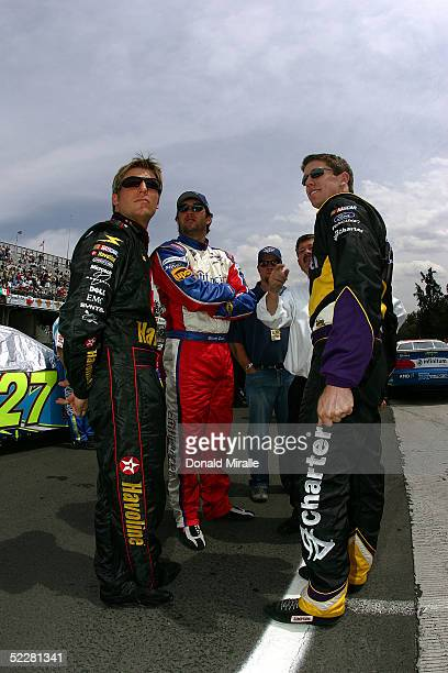 Jamie McMurray, driver of the Havoline Dodge Intrepid, Elliott Sadler, driver of the Citi Financial Ford Taurus, and Carl Edwards, driver of the...