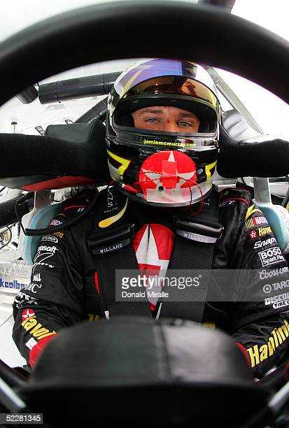 Jamie McMurray, driver of the Havoline Dodge Intrepid, looks on from the seat of his car during qualifying for the Telcel Mexico 200 Nascar Busch...