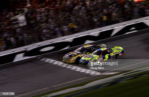 Jamie McMurray, driver of the IRWIN Marathon Tools Ford, crosses the finish line ahead of Kyle Busch, driver of the CARQUEST/Kellogg's Chevrolet, to...