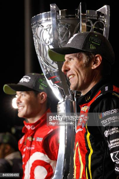 Jamie McMurray driver of the McDonald's Chevrolet and Kyle Larson driver of the Target Chevrolet pose for a photo during the Monster Energy NASCAR...