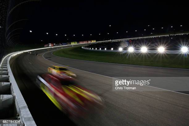 Jamie McMurray driver of the McDonald's Chevrolet leads a pack of cars during the Monster Energy NASCAR Cup Series Go Bowling 400 at Kansas Speedway...