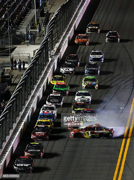 Jamie McMurray driver of the McDonald's Chevrolet spins out spins out in an on track incident during the 3rd Annual Sprint Unlimited at Daytona at...