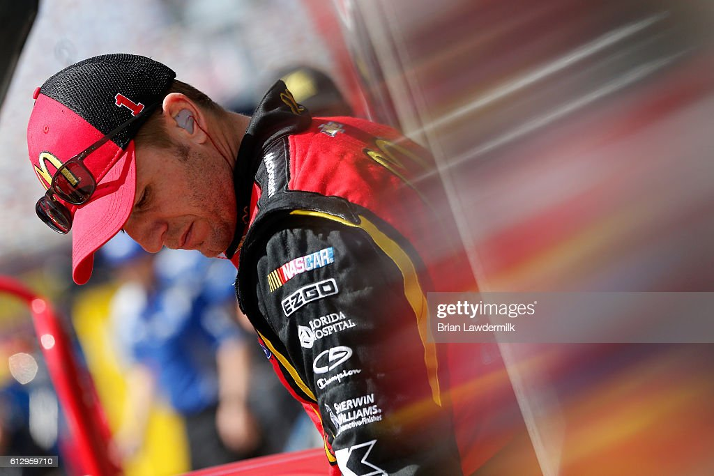 Jamie McMurray, driver of the #1 McDonald's Chevrolet, stands in the garage area during practice for the NASCAR Sprint Cup Series Bank of America 500 at Charlotte Motor Speedway on October 6, 2016 in Charlotte, North Carolina.