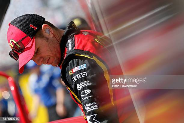 Jamie McMurray driver of the McDonald's Chevrolet stands in the garage area during practice for the NASCAR Sprint Cup Series Bank of America 500 at...
