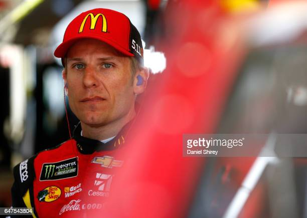 Jamie McMurray driver of the McDonald's Chevrolet stands in the garage area during practice for the Monster Energy NASCAR Cup Series Folds of Honor...