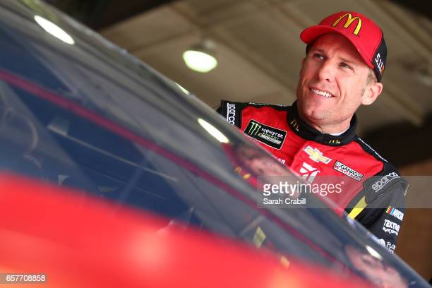Jamie McMurray driver of the McDonald's Chevrolet stands in the garage during practice for the Monster Energy NASCAR Cup Series Auto Club 400 at Auto...