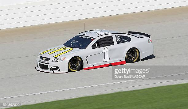 Jamie McMurray driver of the McDonald's/Cessna Chevrolet drives on the track during testing at Chicagoland Speedway on August 23 2016 in Joliet...