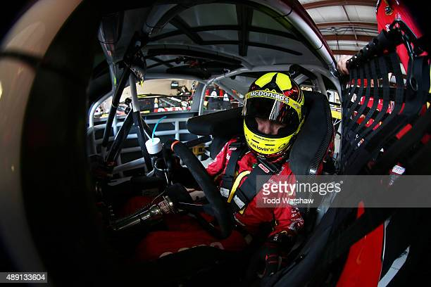 Jamie McMurray driver of the McDonald's/Cessna Chevrolet sits in his car during practice for the NASCAR Sprint Cup Series MyAFibRiskcom 400 at...