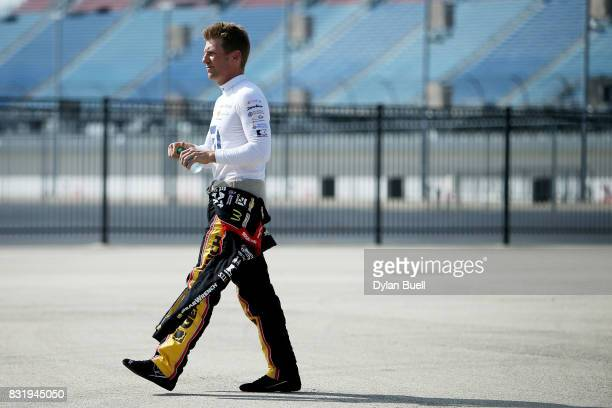 Jamie McMurray driver of the McDonalds/Cessna Chevrolet walks to the garage during testing for the Monster Energy NASCAR Cup Series at Chicagoland...