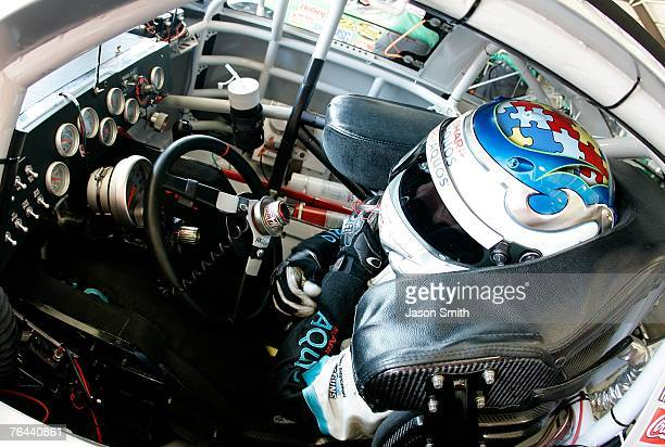 Jamie McMurray driver of the Sharp AQUOS Ford sits in his car prior to practice for the NASCAR Nextel Cup Series Sharp Aquos 500 at California...