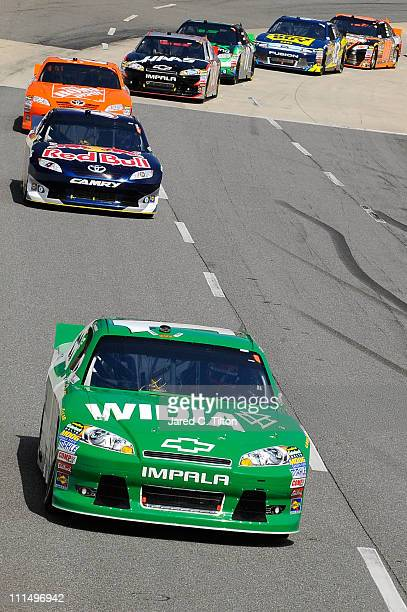 Jamie McMurray, driver of the Widia Chevrolet, leads the field during the NASCAR Sprint Cup Series Goody's Fast Relief 500 at Martinsville Speedway...