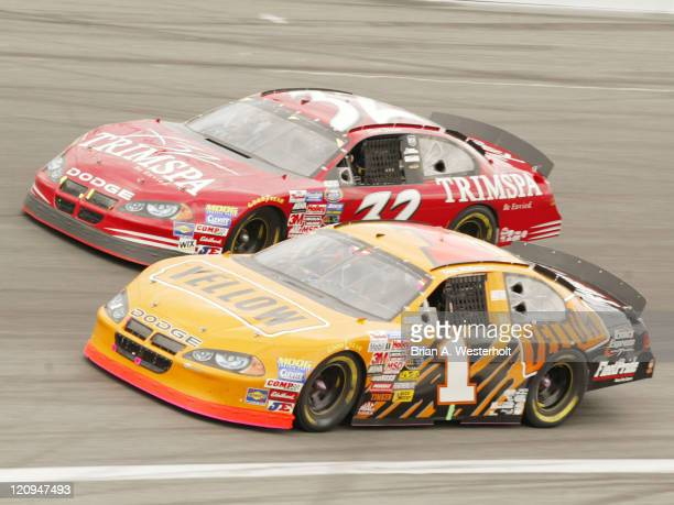 Jamie McMurray passes David Stremme in turn four during the Carquest Auto Parts 300 at Lowe's Motor Speedway in Concord, North Carolina. McMurray...