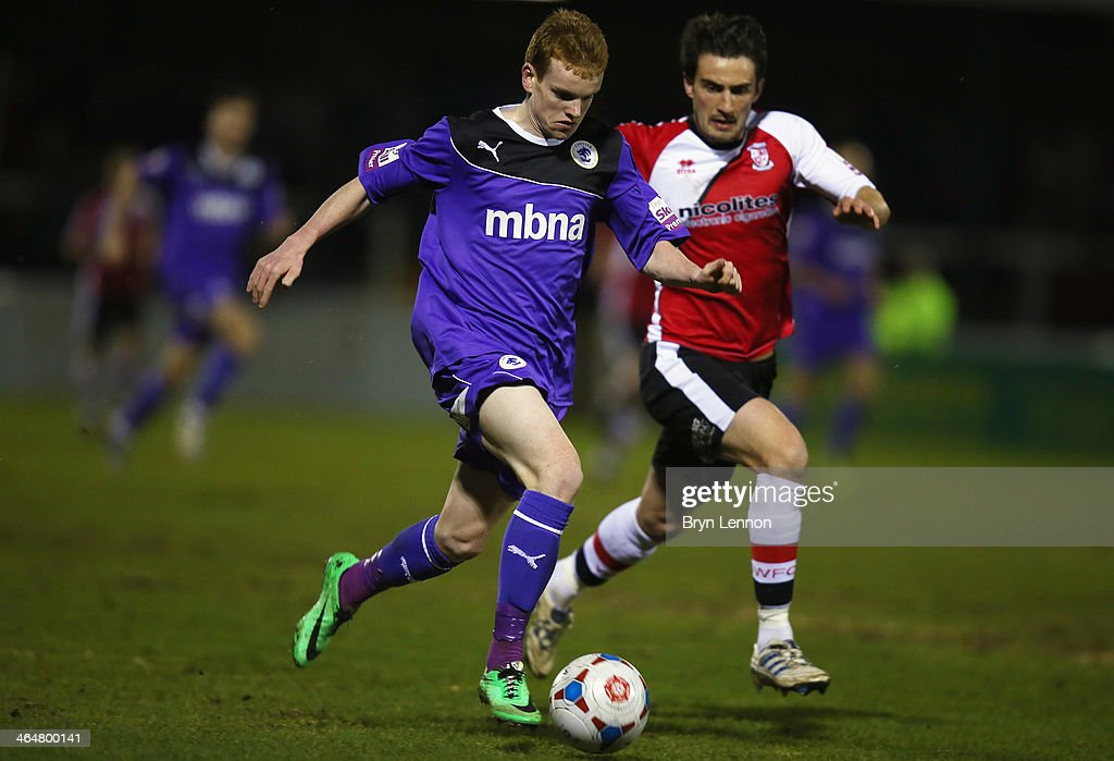Jamie Menagh of Chester City battles with John Nutter of Woking FC during the Skrill Conference Premier match between Woking and Chester at the Kingfield Stadium on January 21, 2014 in Woking, England.