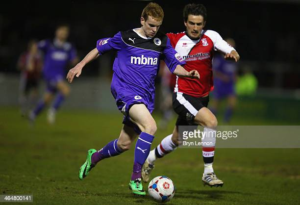 Jamie Menagh of Chester City battles with John Nutter of Woking FC during the Skrill Conference Premier match between Woking and Chester at the...