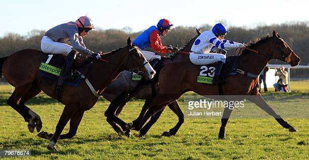 Jamie Moore and Wingman clear the last flight to land The totesport Trophy Hurdle Race run at Newbury Racecourse on February 9 in Newbury England