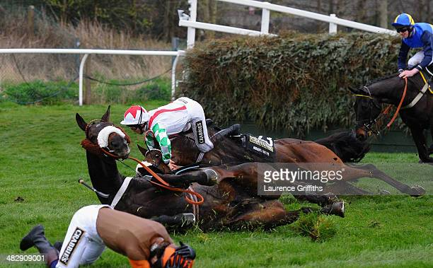 Jamie Moore on Mountainous and Sam Waley-Cohen on Long Run fall at Valentine's during the Crabbie's Grand National Steeple Chase at Aintree...