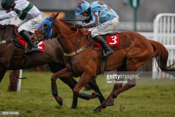 Jamie Moore riding Darebin win The 188Bet Up To £75 Cash Bonus Handicap Steeple Chase at Sandown Park racecourse on March 9 2018 in Esher United...