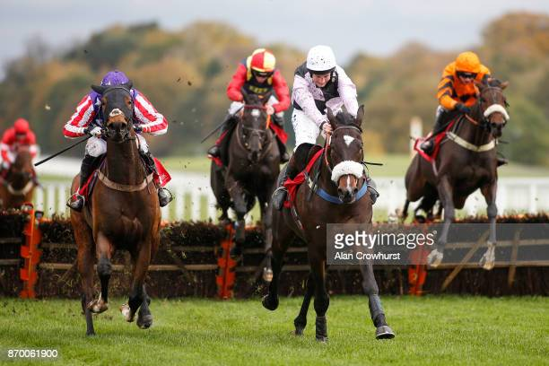 Jamie Moore riding Dell Oro clear the last to win The GL Events UK Novicesâ Hurdle Race at Ascot racecourse on November 4 2017 in Ascot United Kingdom