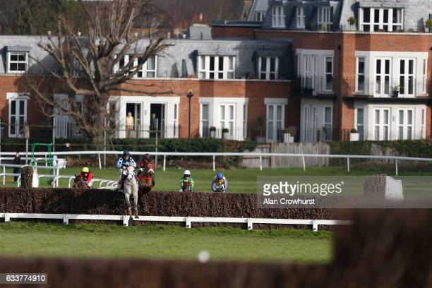 Jamie Moore riding Grey Gold lead over the second last on their way to winning The Betfred 'Treble Odds On Lucky 15's' Handicap Chase at Sandown Park...