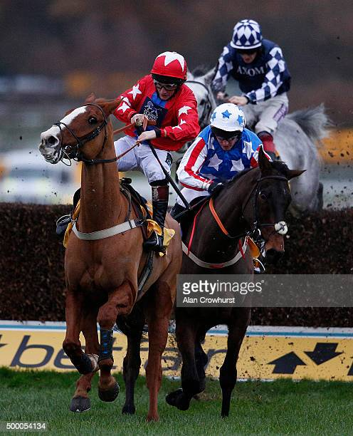 Jamie Moore riding Sire De Grugy clear the last to win The Betfair Tingle Creek Steeple Chase from Special Tiara at Sandown racecourse on December 05...