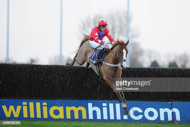 Jamie Moore riding Sire De Grugy clear the last to win The williamhill.com Desert Orchid Steeple Chase at Kempton Park racecourse on December 27,...