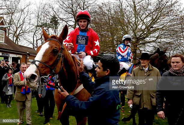 Jamie Moore riding Sire De Grugy return after winning The Betfair Tingle Creek Steeple Chase at Sandown racecourse on December 05 2015 in Esher...