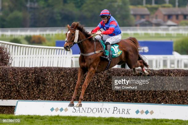 Jamie Moore riding Step Back clear the last to win The bet365 Gold Cup Handicap Steeple Chase at Sandown Park racecourse on April 28 2018 in Esher...