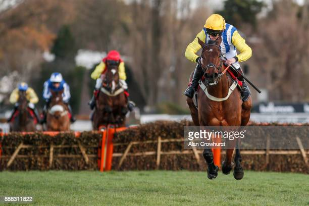 Jamie Moore riding Sussex Ranger clear the last to win The Tokio Marine Kiln Introductory Juvenile Hurdle Race at Sandown Park racecourse on December...