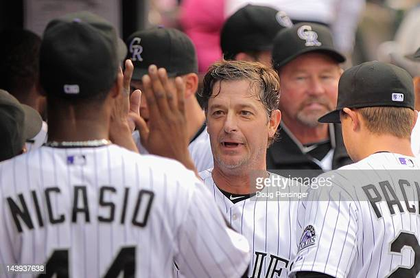 Jamie Moyer of the Colorado Rockies celebrates in the dugout after he scored on a two RBI double by Carlos Gonzalez of the Colorado Rockies off of...
