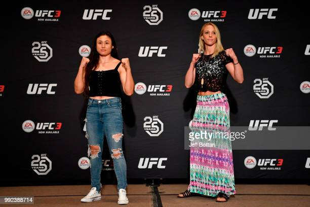 Jamie Moyle and Emily Whitmire pose for the media during the UFC 226 Ultimate Media Day at Palms Casino Resort on July 5 2018 in Las Vegas Nevada