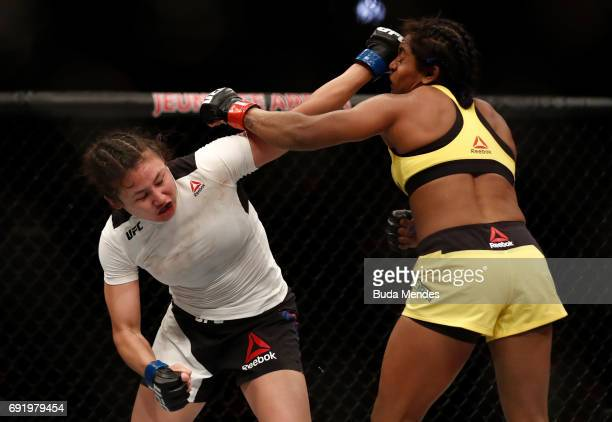 Jamie Moyle punches Viviane Pereira of Brazil in their womens strawweight bout during the UFC 212 event at Jeunesse Arena on June 3 2017 in Rio de...