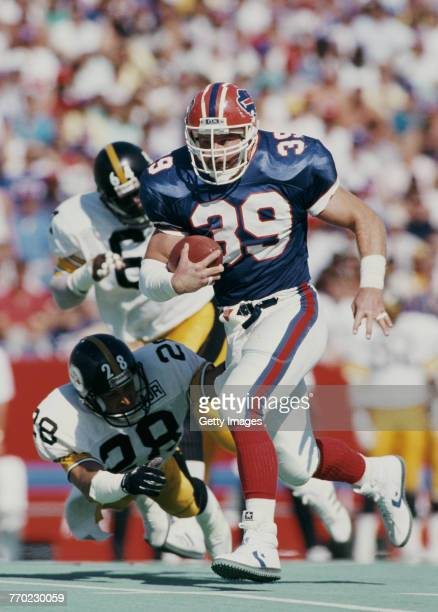 Jamie Mueller Running Back for the Buffalo Bills avoids the diving tackle attempt by Lupe Sanchez of the Pittsburgh Steelers during their American...