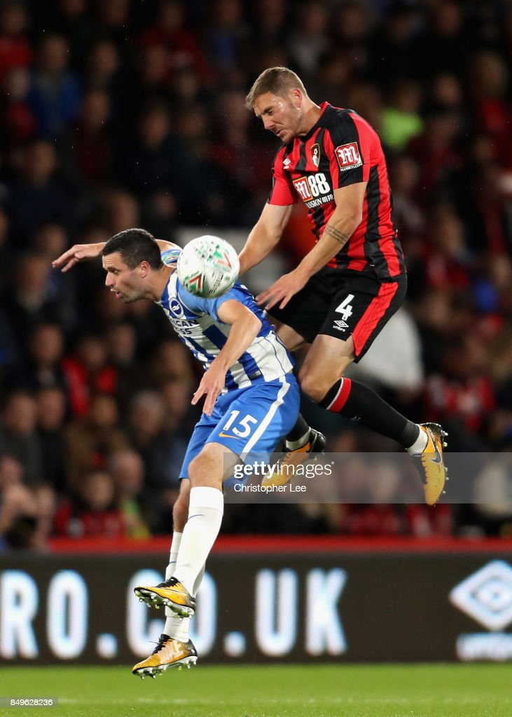 Jamie Murphy of Brighton and Hove Albion and Dan Gosling of AFC Bournemouth battle for possession in the air during the Carabao Cup Third Round match between AFC Bournemouth and Brighton and Hove Albion at Vitality Stadium on September 19, 2017 in Bournemouth, England.