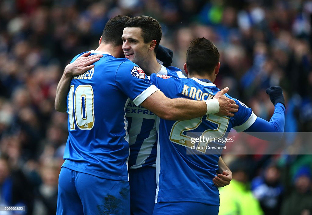 Jamie Murphy (C)of Brighton celebrates with team mates Anthony Knockhaert (R) and Tomer Hemed (L) after scoring the first goal of the game during the Sky Bet Championship match between Brighton and Hove Albion and Bolton Wanderers at The Amex Stadium on February 13, 2016 in Brighton, England.